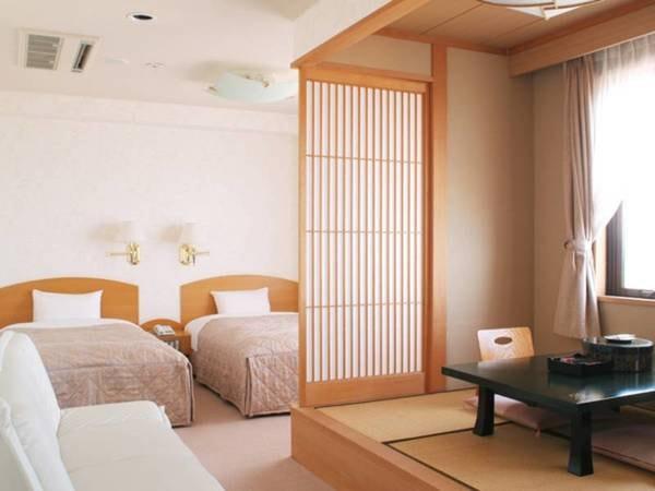 [和洋室/例] オーシャンビュー、ベッドが付いた12畳の和洋室