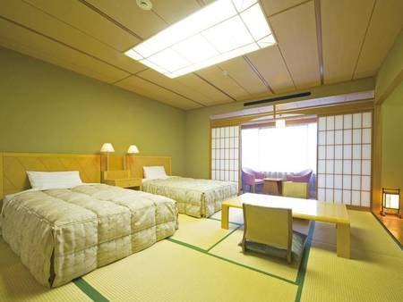 【ツインベッド付き和室/一例】和と洋の融合。和の落ち着きの中に洋の機能性を備えている。ベッドだから寝起きもラクラク