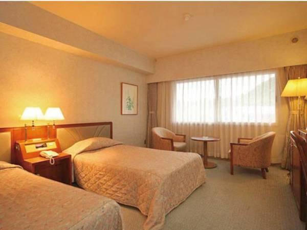 【洋室/ツインタイプ一例】清潔で落ち着いた雰囲気のお部屋。ご夫婦、ご友人とのご旅行に