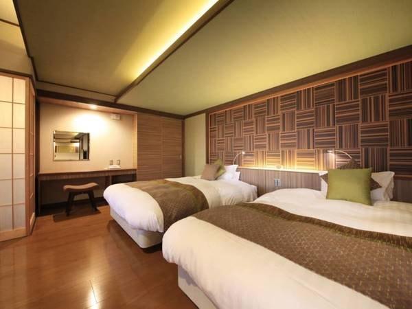 【<別邸うらら>デラックス ツインベッドスペース/例】ベッドスペースには、眠りの質にこだわったシモンズ製ベッドを設えております。