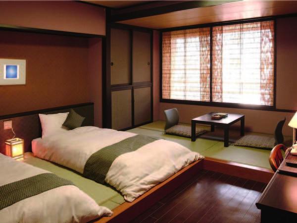 ベッドが置かれた和室/10畳