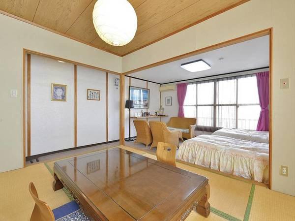 寛ぎスペースのある広々とした和洋室(12畳【和室6畳+洋室6畳】一例)。ベッドをご希望の方におすすめ。別府湾や湯けむりを望む好立地