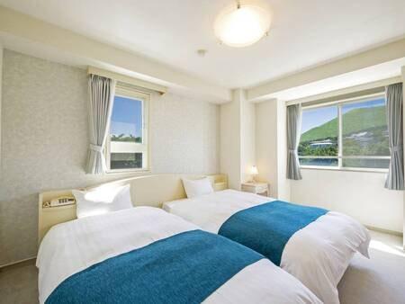 【2LDKオーシャンビュースイート・寝室/例】独立した寝室で快適にお休みいただけます