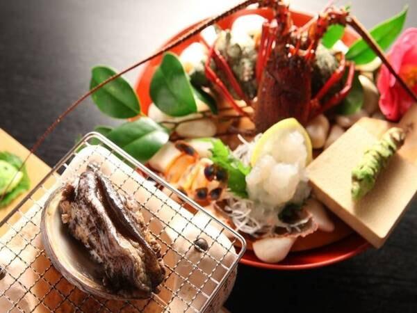 贅づくしプラン一例:伊勢海老の生き造りとあわびのおどり焼き
