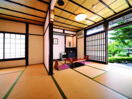 【客室/例】清潔感溢れる掘りごたつ付14畳客室にご案内