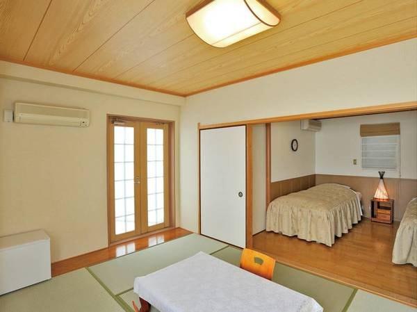 【山側眺望・露天風呂付和洋室/例】ベッドを2台備えたお部屋。温泉露天風呂付き!