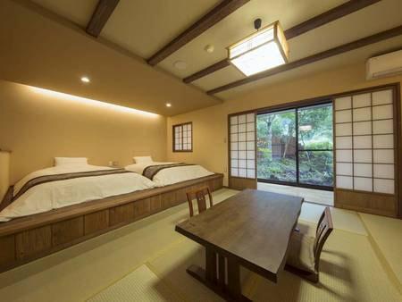 【和洋室/例】畳の温もりとベッドの利便性を兼ね備えた設え