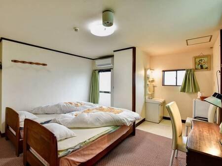 *【ツインルーム】広々としたベッドルームで安眠の夜をお過ごし下さい。