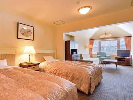 【客室/例】見晴しの良い最上階で58㎡のツインルーム。記念日等におススメ※全室禁煙