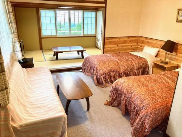 【和洋室一例】畳の間で寛ぎ、ベッドでぐっすり眠れるお部屋です