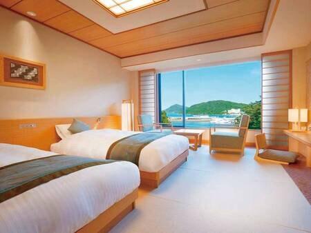 【和モダンツイン/例】畳のお部屋にシングルベット2台と窓側にソファーセットを配置したお部屋です